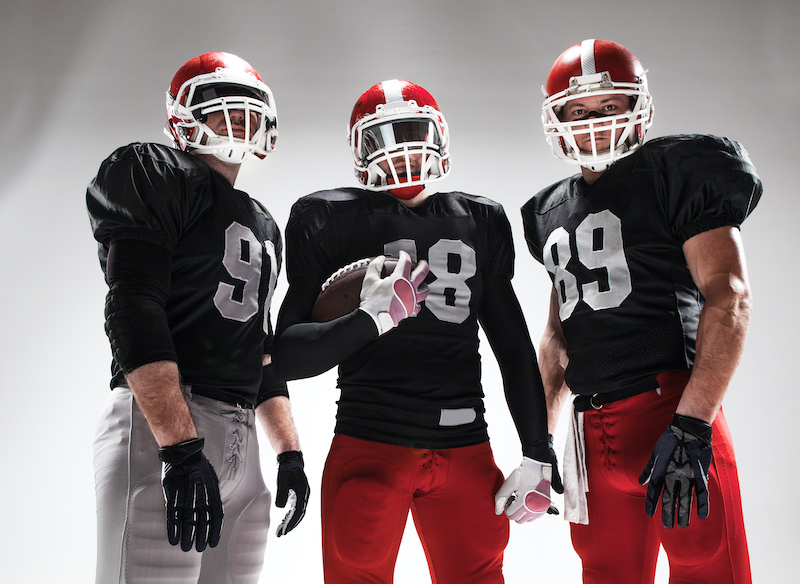 Image of three American Football players